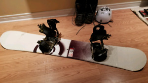 Snowboard, snowboard boots and helmet