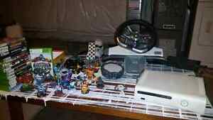 Xbox 360 with wireless steering wheels,  headset,  and 19 games