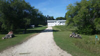 12 acre rural w house and 7,000+ sf heated shop