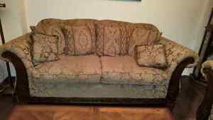 Two  seater with carved wood work, very comfy in mint conditio