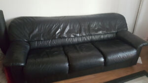 black leather couch and matching chair