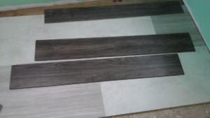 3 boxes (64.5 sq ft) of new never used luxury vinyl plank / tile