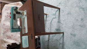 Sewing machine with cabinet.