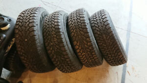 """235 65r16 Goodyear Nordic Snow tires on 16"""" steel rims for sale"""