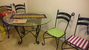 Glass and cast iron dining set