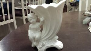 most delicate figurine of Angel sitting on a corne d'abondance #