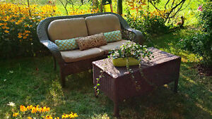 Resin wicker patio sofa and coffee table