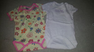6 month  onsies . Baby girl both for 1$