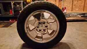 One chevy rim and tire