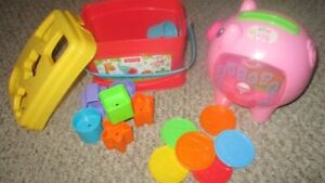 Toy piggy bank and bucket of shaped blocks