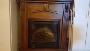 Dimplex fireplace with remote. Real wood.