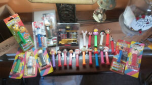 25 Pez dispensers some unopened