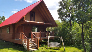 Log Cabin on 1/2 acre treed lot in White Sands Alberta