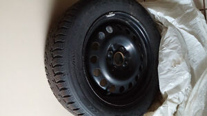 4 Winter Tires with new rims that fit Chevy Spark