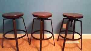 3 adjustable wooden top stools.