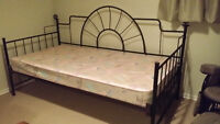 Black wrought iron day bed with mattress