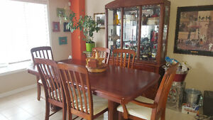 solid wood table, chairs and hutch