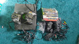 Xbox and playstation 2 with games
