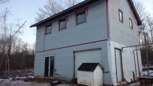 8 acres, 2 bed mobile, 2 storey garage, small farm