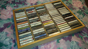 Collection of at least One Hundred Cassettes and Two Racks
