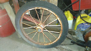 cool steel spoked wheel with rubber tire