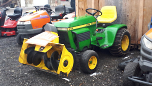 Riding tractor with snow blower