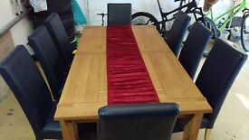 Archibalds Solid Oak Dining Table and 8 Navy high backed leather Dining chairs.Cost £2900
