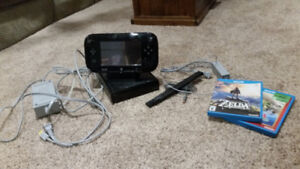 Nintendo Wiiu with 4 downloaded games, and 2 separate