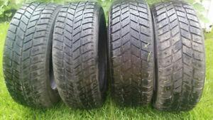 4 pneus d'hiver avec clous  demi usure   205/55R16