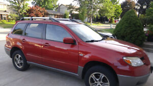 2006 Red Mitsubishi Outlander SUV