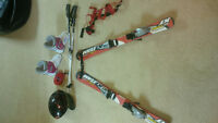 skis boots poles helmet safety strap
