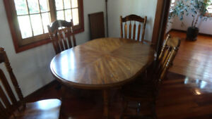 Oval Dining room table and 6 chairs (inc. captain's chair)