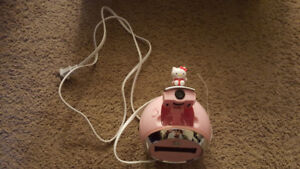 Hello kitty car window shade and alarm clock asking 30 for both