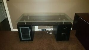 Black desk with floating glass top and silver accents