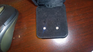 Diamond earrings > .255 carats each, G colour, VS2