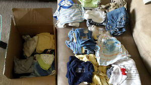 boxes full of 0-3, 0-6 months baby boy clothes