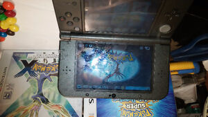 Black Nintendo 3DS XL with Charger and 2 Pokemon Games