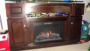 Solid electric fireplace