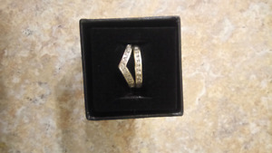 2 white  gold rings with diamonds size 7