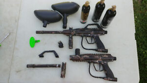 Two JT paintball markers and accessories