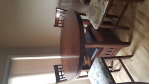 Solid bar height table with 6 chairs