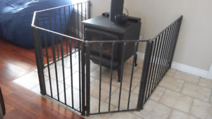 Solid steel fence gate for woodstove or fireplace
