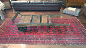 Reclaimed antique industrial dolly cast iron coffee table.