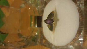 Beautiful 10ct gold ring with purple sapphire and diamonds