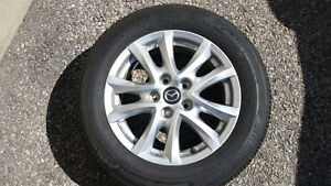 OEM 2015 Mazda 3 (16 in. Alloys w/ tires; NO SCTRACHES)