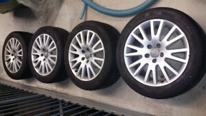 Audi OEM rims and all season tires
