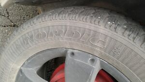 (4) P235/55R17 Goodyear Notdic Winter Tires on Saturn Wheels St. John's Newfoundland image 4