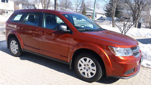 11, 000 KMS.   2014 Dodge Journey