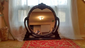 Beautiful polished oval mirror, dark read cherry color.
