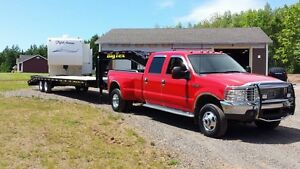 TRAVEL TRAILER, BOAT AND FLATDECK TRANSPORT SERVICE